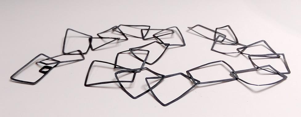 Halssmykke af firkanter